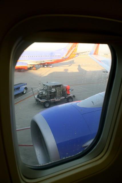 Onboard WN8725 to OSH, N940WN.