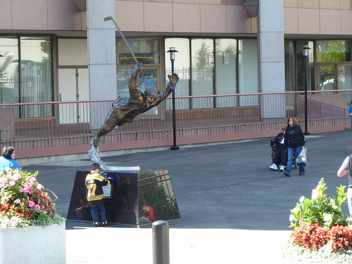 Little kid in a Bruins jersey at the statue of Bobby Orr 17 September