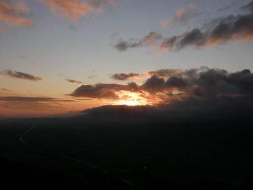 Sun rising behind Great Mell Fell