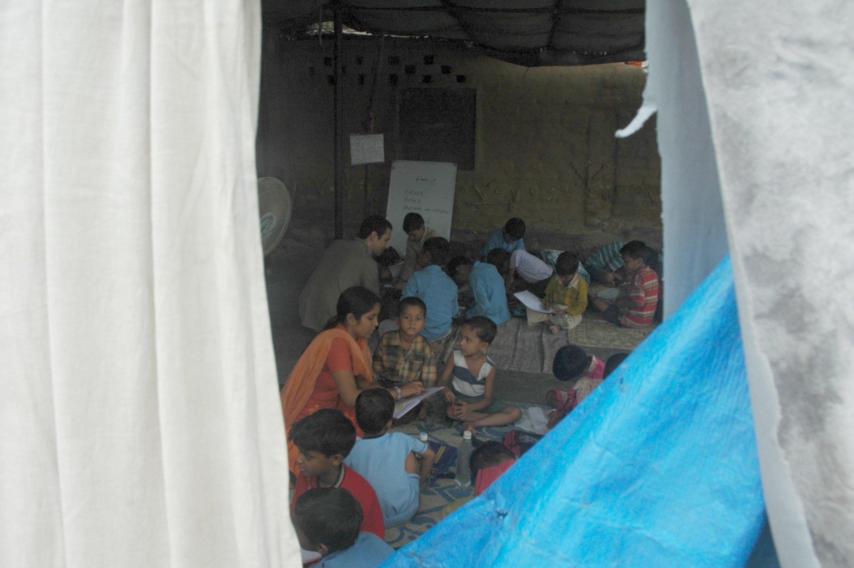 World through the hole, slum school, New Delhi, India