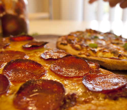Pepperoni and Gruyere Pizza and Tomato Buttered Pizza with Anchovies and Soft Gruyere