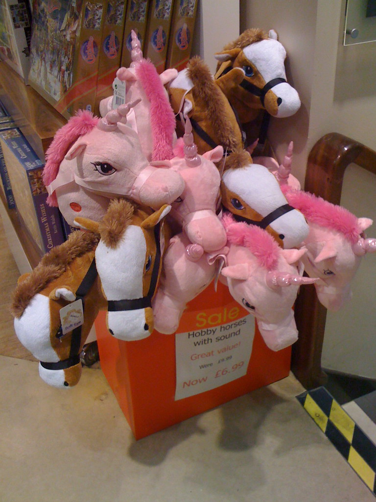 Hobby-horses available in white-and-brown horse version and pink unicorn version.