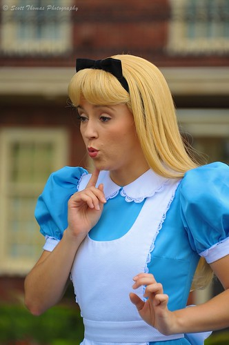 Alice striking a classic pose when meeting young guests in Epcot's United Kingdom pavilion in Walt Disney World, Orlando, Florida.