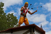 """Rooftop performer with Devil Sticks • <a style=""""font-size:0.8em;"""" href=""""http://www.flickr.com/photos/33121778@N02/6118043666/"""" target=""""_blank"""">View on Flickr</a>"""
