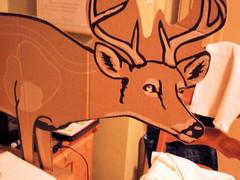 Printed side of cardboard deer shaped target with deer face