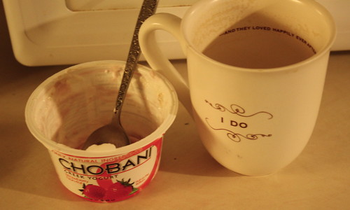 chobani and empty coffee cup