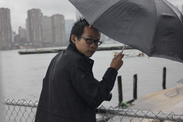 Man with camera and umbrella