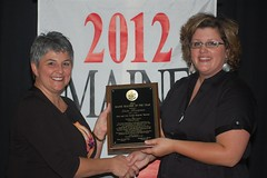 Alana Margeson accepts the 2012 Teacher of the Year Award from Jennifer Pooler of the Maine Department of Education
