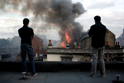 Proud of this one.  I shouted to these two blokes above if I could photograph from their roof, they agreed and I climbed up a wall with the help of a shop owner below. by jasoncuddy