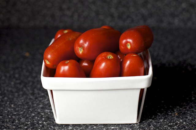 a basket of plum tomatoes