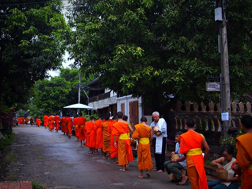 Monks receiving daily morning alms (tak bat), Luang Prabang