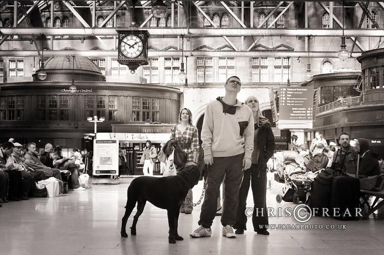 Couple awaiting their train at Glasgow Railway station.