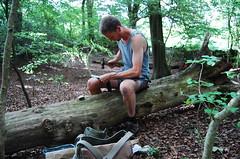 scythe peening in the woods