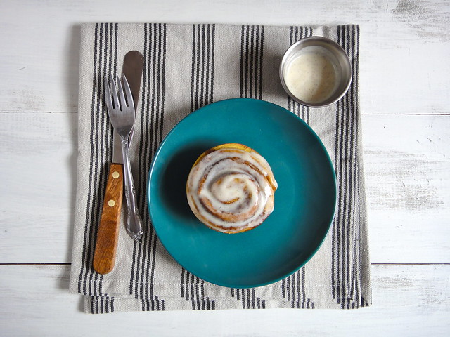 Pumpkin spice cinnamon roll with cream cheese icing