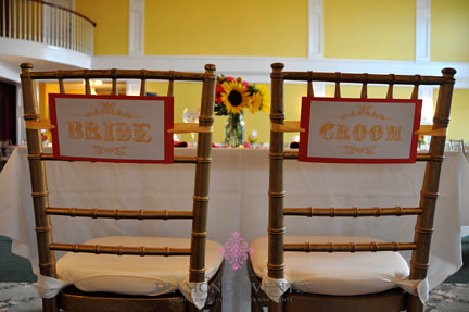 Bride and Groom signs on the back of chiavari chairs
