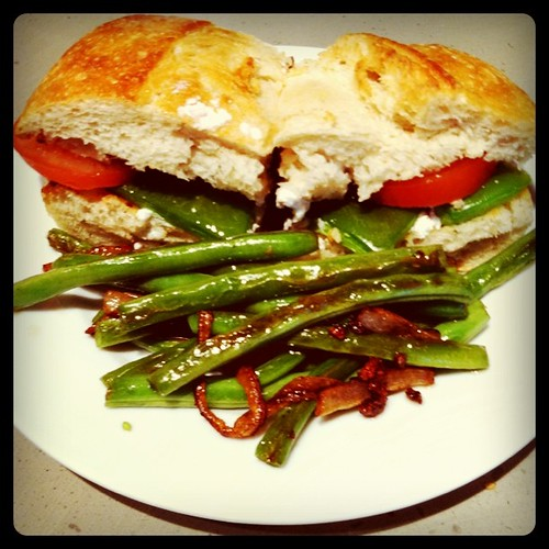 Goat cheese, roasted bell peppers, and tomatoes on French bread with balsamic vinegar. Side of green beans sautéed with garlic and onions. Yum!