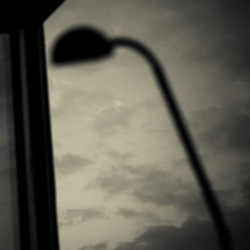 the silhouette of a lamp