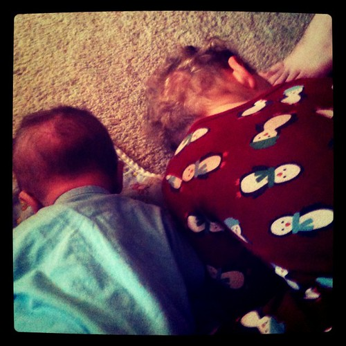 Showing what to do during tummy time.