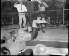 Boxer knocked through the ropes