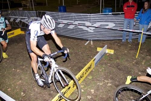 Jonathan Page bunny hops the barriers as Ben Berden runs