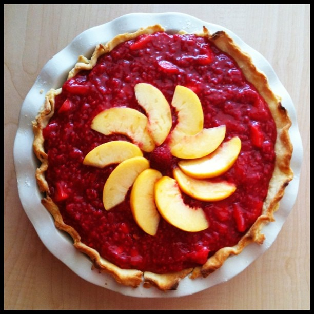 #raspberry and fresh #peach #pie tonight. By far the tastiest thing I've ever made. Holy yumm!