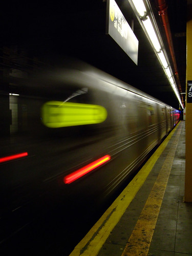 Subway train leaving station by S.Stikine 