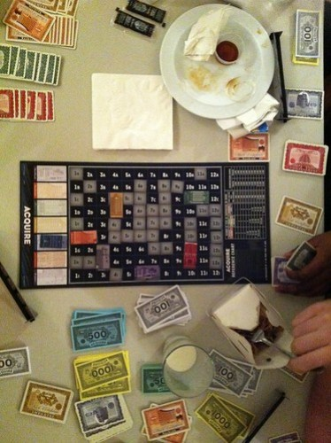 Us playing Acquire on our weekly game's night, while eating Chinese food.