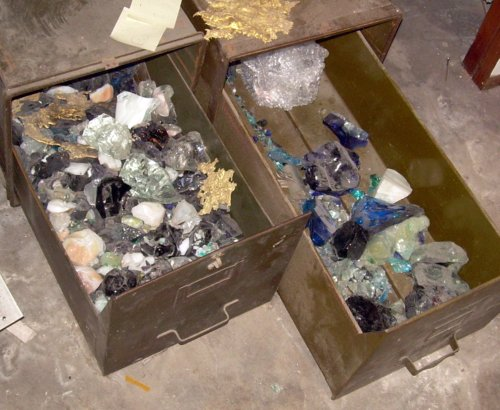 Drawers of glass objects