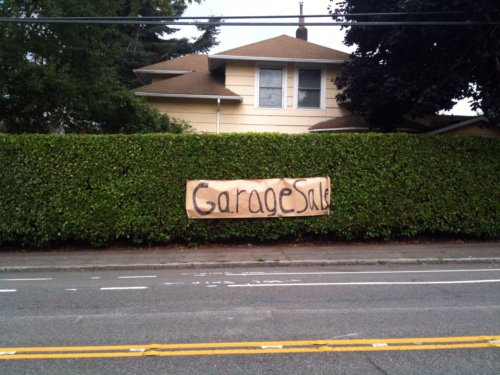 Large sign on hedge