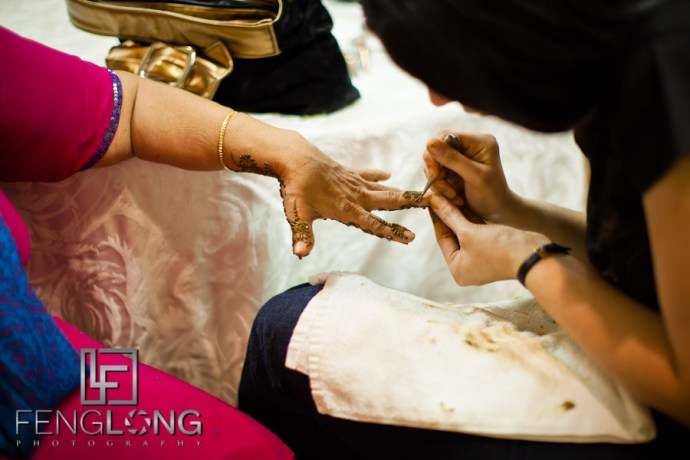 Applying Henna to Hands   Shamz & Sana's Wedding Day 1   Hyatt Place Atlanta Airport South   Atlanta Indian Photographer