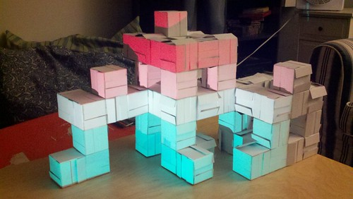 Projection mapped business card cubes