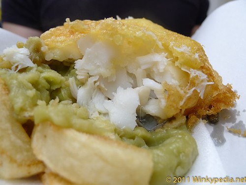 Deep fried cod on mashy peas and chips in Cromer