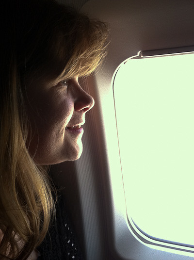 The wife eagerly awaits takeoff.
