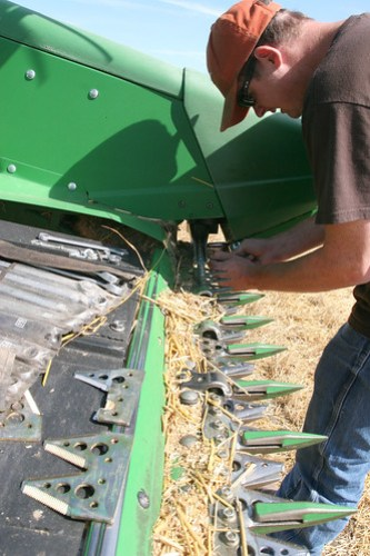 Leon fixes a broken knife on our header.