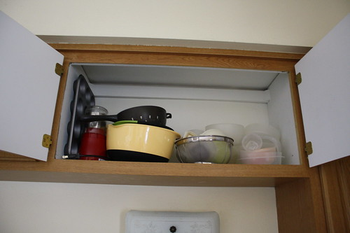 before reorganizing upper cabinet