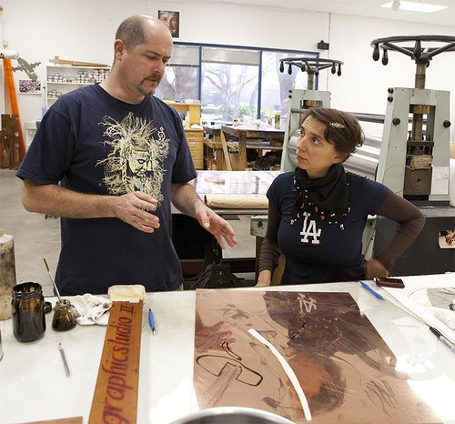 Tim Baker and Iva Gueorguieva work on new prints at USF Graphicstudio