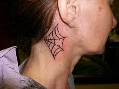 Spider web tattoo