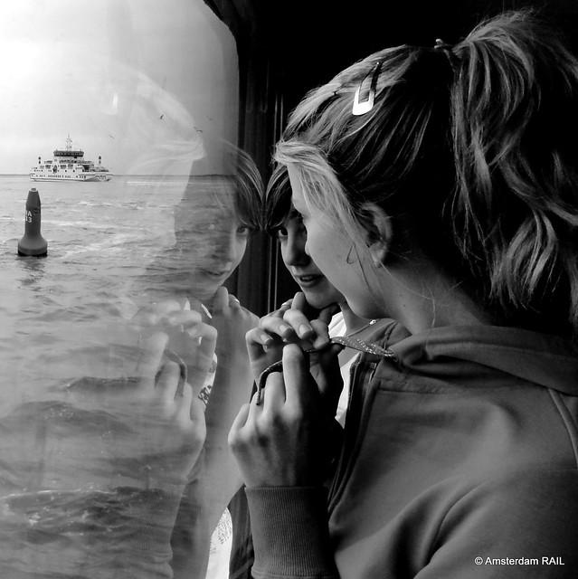Dreamy girls' reflections at sea