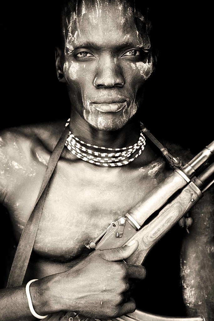 Meruti - very strong looking mursi boy from omo vally / ethiopia