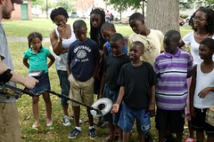 Brandon Bies demonstrating metal detector for Macedonia Baptist Church Summer Learning Center children, Civil War Archeology in Lafayette Square