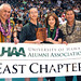 University of Hawaii Alumni Association's Douglas Inouye, middle left, and Alvin Katahara, far right, presented the award and a chapter banner to UHAA-East's Karen and David Liu.