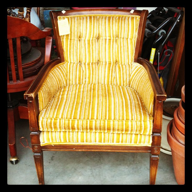 My new chair. I decided on this one over the rocking chair because it has a smaller footprint. And Scott will like it better. :)