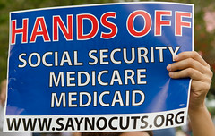 """Sign at Occupy St Pete: """"Hands Off Social Security, Medicaid Medicare""""  """"www.SayNoCuts.org"""""""