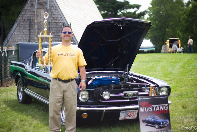A man, his car and a trophy