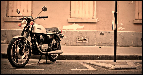 Vintage Honda 125 in the streets of Paris