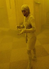 Woman covered in ash seeks shelter in a building in lower Manhattan, by Stan Honda