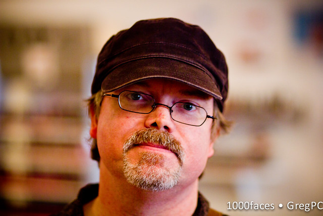 Face - man with a goatee, glasses and a hat