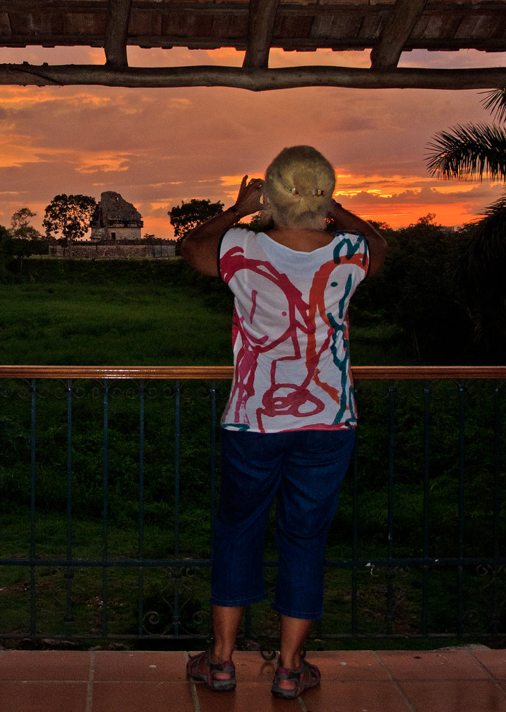 Chris photographs a sunset and El Caracol observatory temple from our hotel