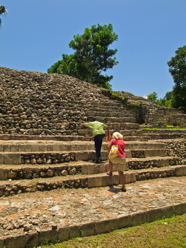 "The custodian leads us up the ""Palace of the Stuccos"" in Acanceh"