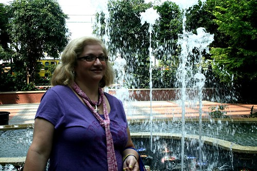 Dianne posing at the Gaylord fountain